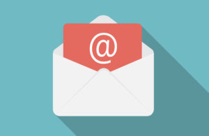 White illustrated mail envelope with @ symbol on blue background