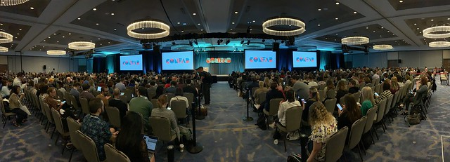Panoramic of people in a large conference room for Confab 2019